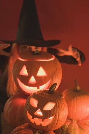 candlelit: Pumpkin lanterns and witch for Halloween