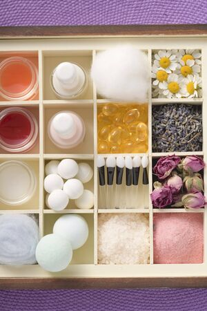 bath supplement: A selection of beauty products and flowers in type case