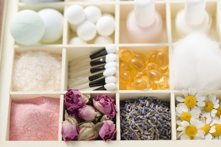 bath supplement: Various beauty products and flowers in type case LANG_EVOIMAGES