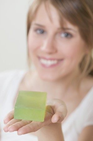 20 to 25 year olds: Woman holding green soap