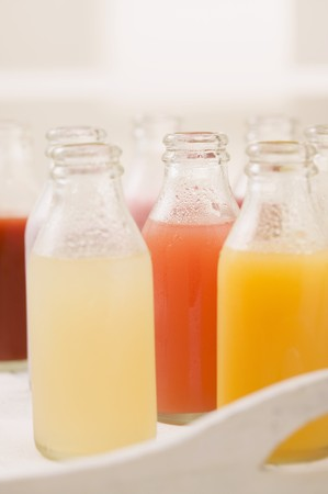 soda pops: Various different juices in small bottles on tray