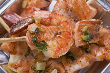 prawn skewers: Salmon and prawn skewers with mint in aluminium dish LANG_EVOIMAGES