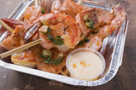 prawn skewers: Salmon & prawn skewers with mint & sauce in aluminium dish LANG_EVOIMAGES