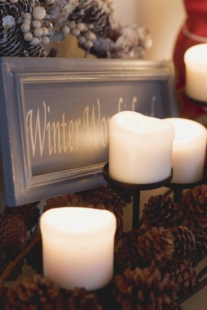 ignited: Candles, pine cones and festive sign