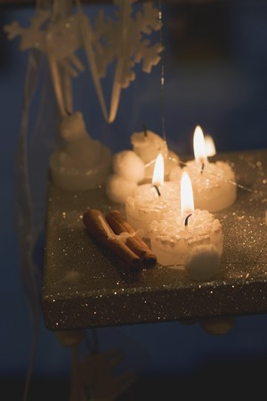 ignited: Assorted candles and Christmas decorations