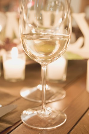 candlelit: Glass of white wine on Christmas table
