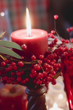 Red candle with berries