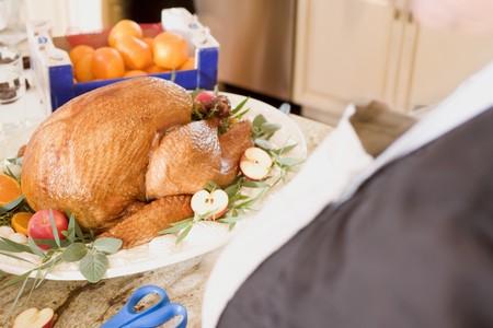 garnishing: Garnishing roast turkey on a platter