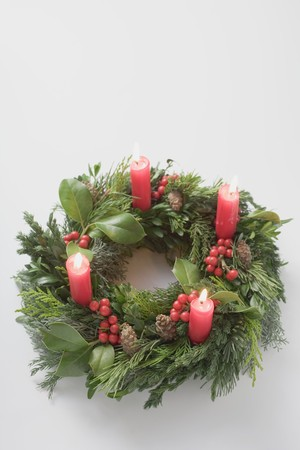 ignited: Advent wreath with four burning candles LANG_EVOIMAGES