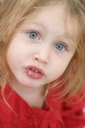 leavings: Small girl with crumbs around her mouth