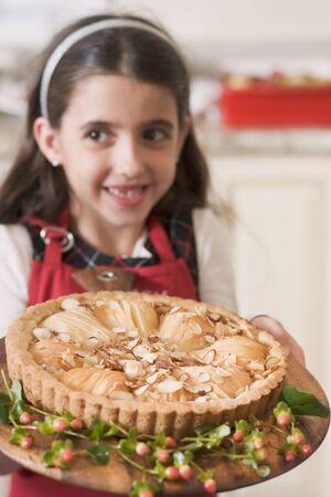 apple tart: Girl holding freshly-baked apple tart