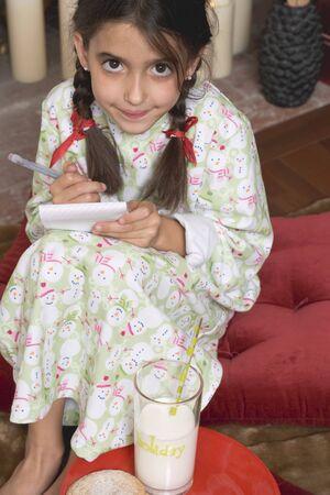 nightdress: Girl writing her Christmas wish list