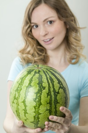 well beings: Woman holding watermelon