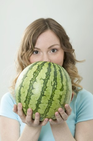 hold ups: Woman holding watermelon