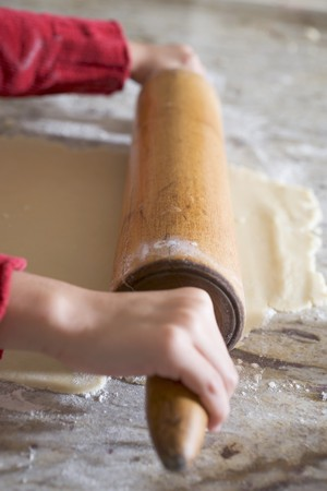 biscuit dough: Childs hands rolling out biscuit dough
