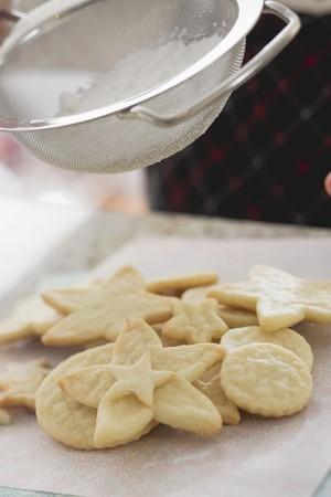 sprinkling: Sprinkling biscuits with icing sugar