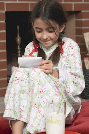 wish list: Girl writing her Christmas wish list