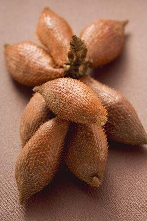 brownness: Salak fruits on brown background LANG_EVOIMAGES