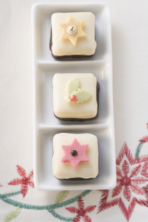 petit: Three petit fours for Christmas (overhead view)