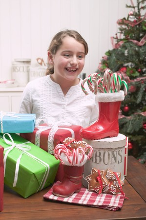 10 to 12 year olds: Girl with Christmas gifts