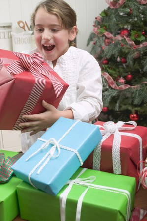 10 to 12 year olds: Girl with lots of Christmas gifts