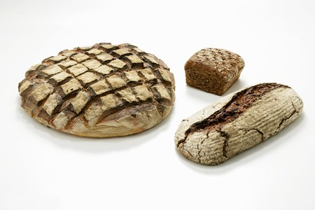 several breads: Three different loaves of wood-oven bread