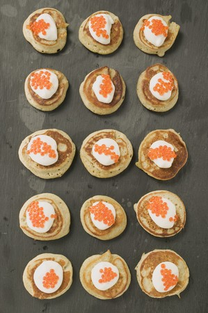 made russia: Blinis with sour cream and caviar (overhead view)