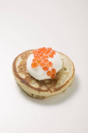 blini: Blini with sour cream and caviar