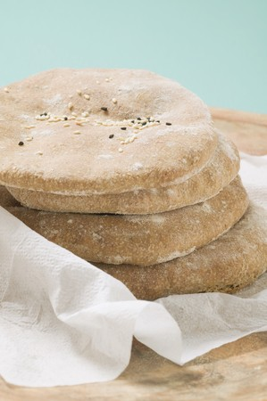 several breads: Flatbread with sesame seeds, stacked