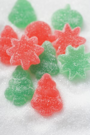 christmassy: Christmassy jelly sweets on white sugar LANG_EVOIMAGES