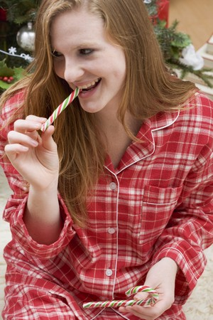 25 to 30 year olds: Woman eating candy cane
