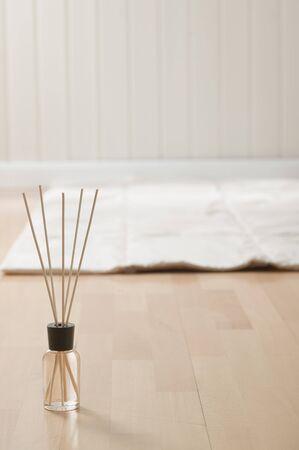 incense sticks: Incense sticks and mat on parquet floor