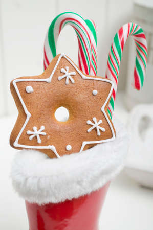 wellie: Gingerbread star and candy canes in red rubber boot
