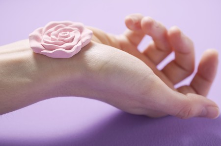 well beings: Rose soap on someones hand LANG_EVOIMAGES