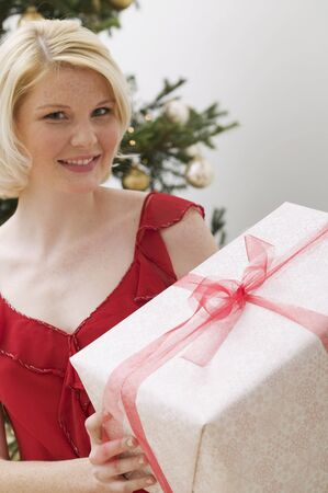 25 to 30 year olds: Woman holding Christmas parcel