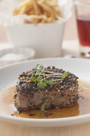 peppered: Peppered steak with cress, chips in background