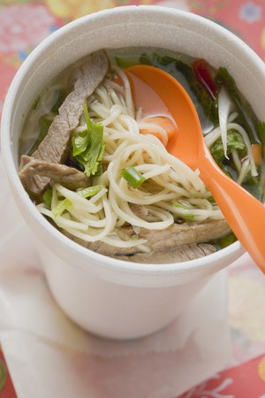 asian noodle: Asian noodle soup with beef in polystyrene cup