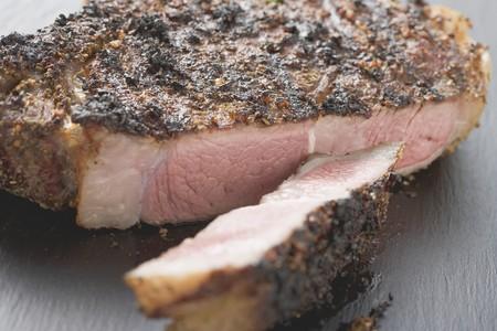 rib eye: Spicy fried rib eye steak, a slice cut off