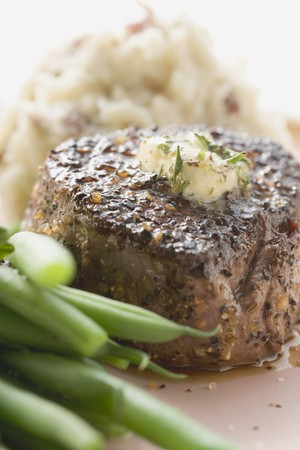 peppered: Peppered steak with herb butter, beans and mashed potato
