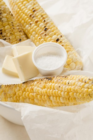 qs: Grilled corn on the cob with salt and pieces of butter