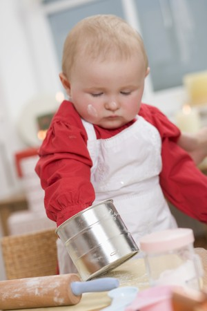 12 step: Baby helping to bake Christmas biscuits