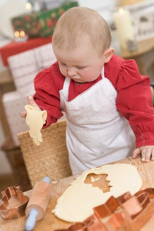 12 step: Baby holding cut-out Christmas biscuit