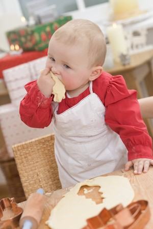 12 step: Baby eating unbaked Christmas biscuit