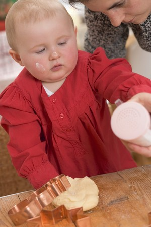 12 step: Mother and toddler baking Christmas biscuits