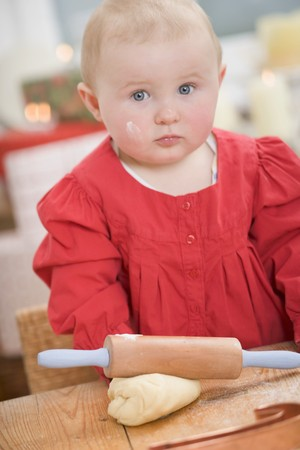 12 step: Toddler with rolling pin and ball of dough LANG_EVOIMAGES