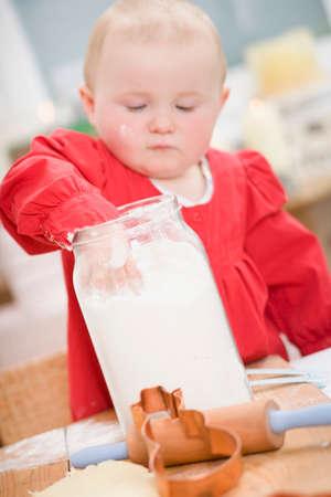 12 step: Toddler reaching into jar of flour