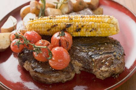 zea: Grilled steak with corn on the cob, cherry tomatoes, potatoes LANG_EVOIMAGES