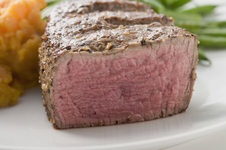 qs: Beef steak with vegetables