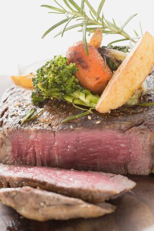 sirloin steak: Sirloin steak with vegetables and rosemary