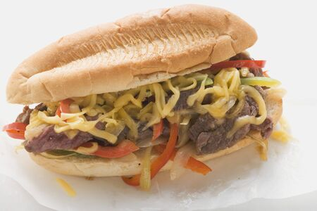 hero sandwich: Steak sandwich with peppers and cheese LANG_EVOIMAGES
